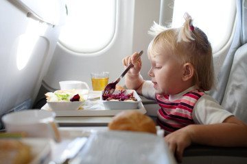 Learn what to pack when flying with kids and what they can eat inflight