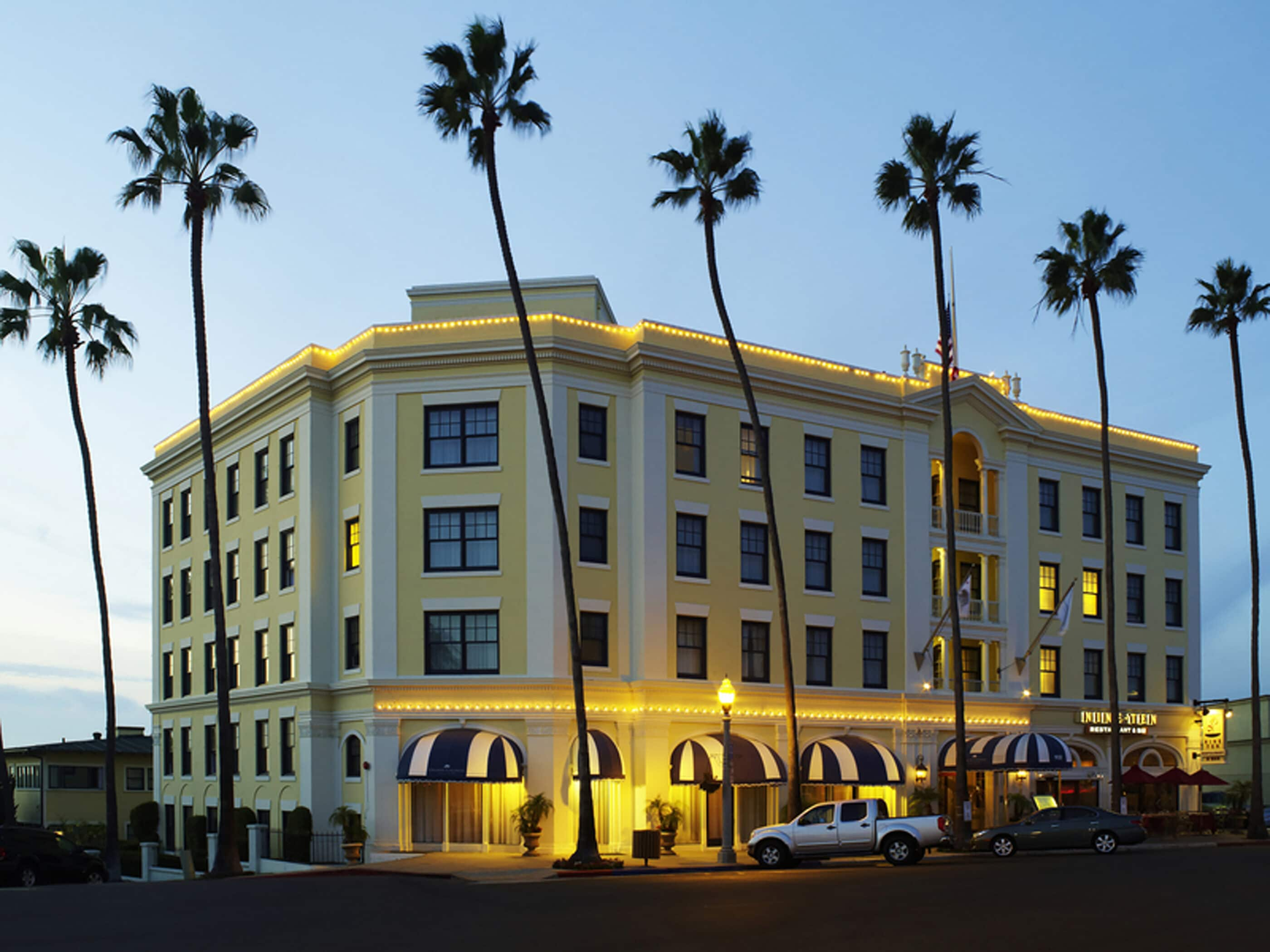 Exterior of Grande Colonial hotel in La Jolla at sunset