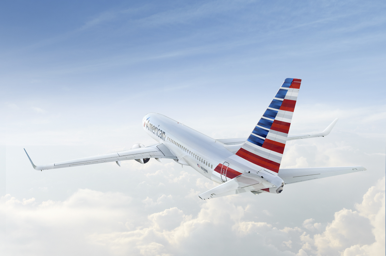 An American Airlines 737 flies above the clouds.