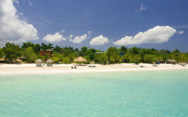Visit Jamaica for gorgeous beaches, luxury resorts, amazing food (jerk chicken and beyond) and incredibly friendly people!