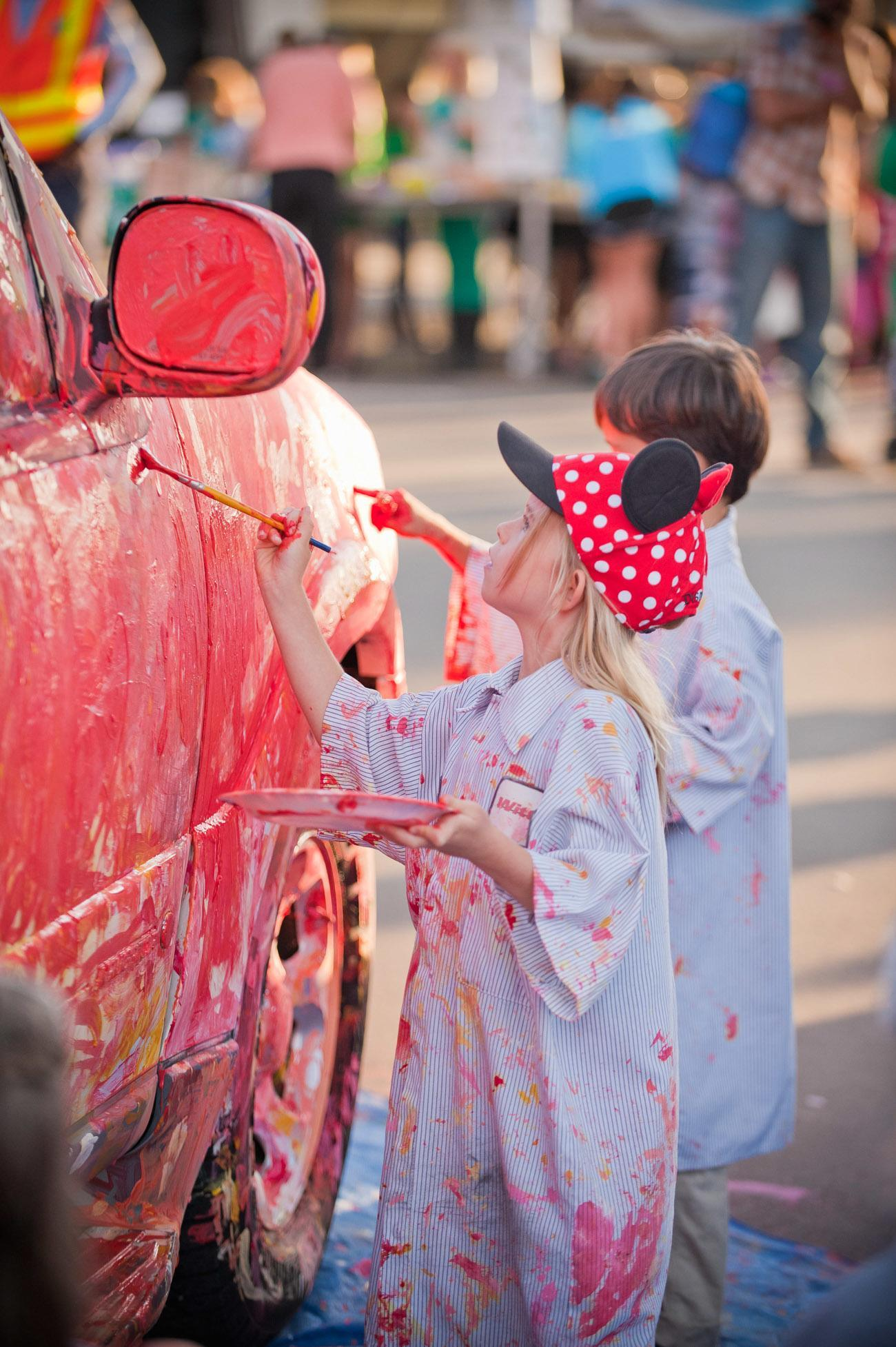 Kids will have fun painting a car at the La Jolla Art and Wine Festival.