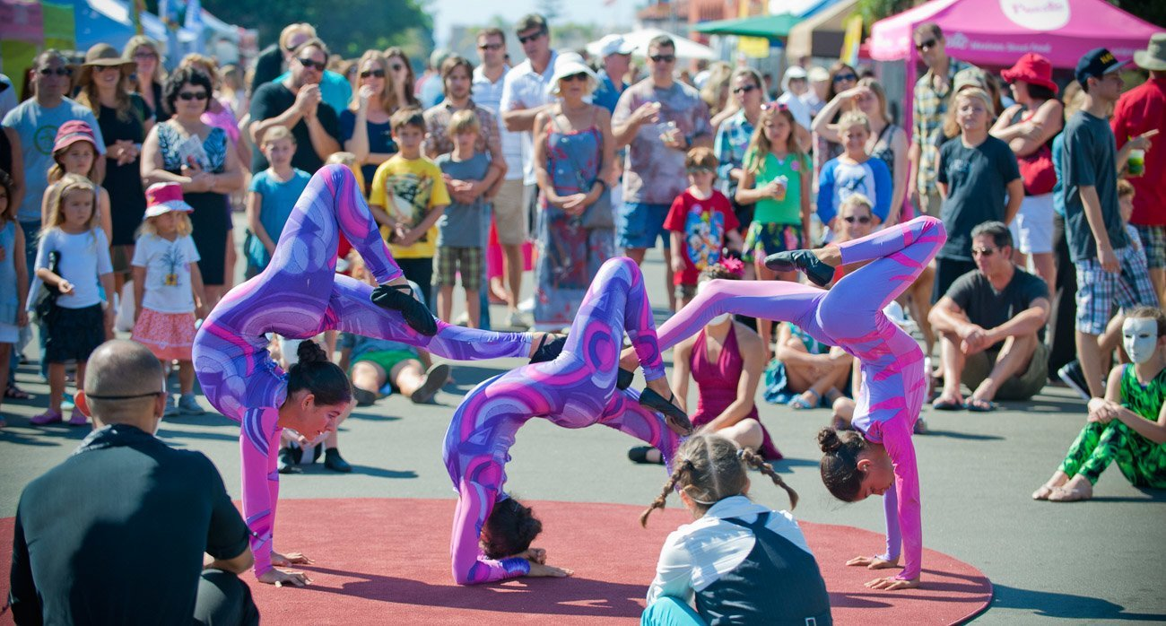 Live entertainment at the La Jolla Art and Wine Festival includes circus performers and other roaming acts.