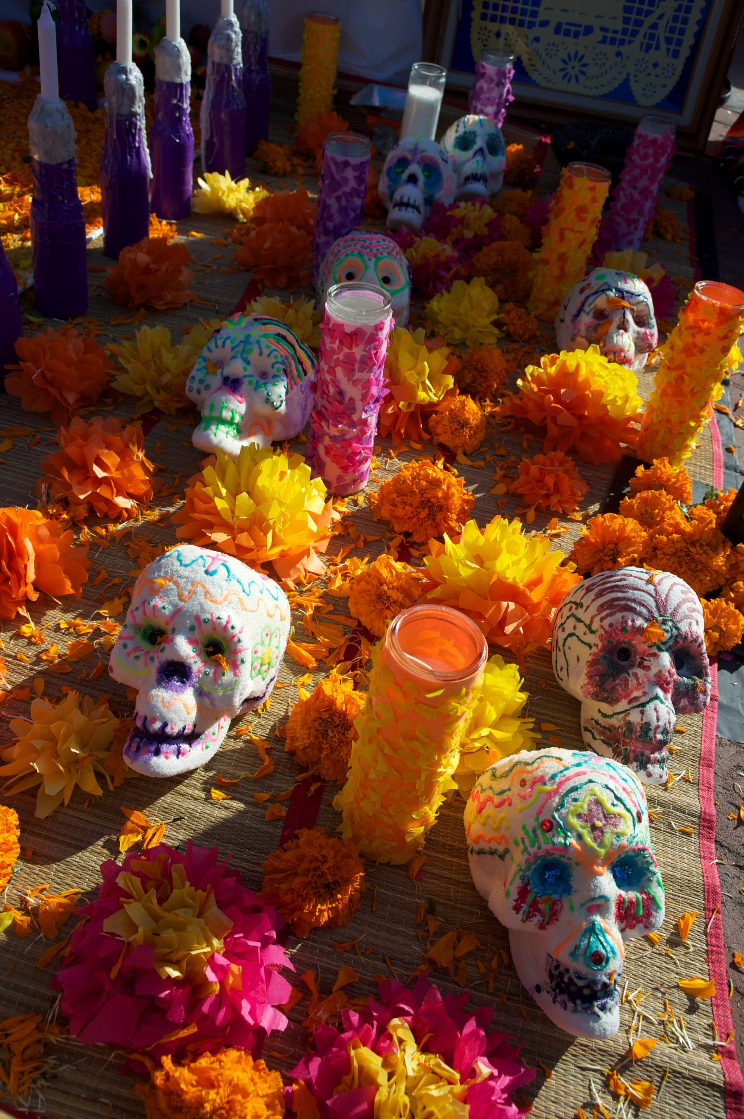 Dia de los Muertos altar with marigolds and sugared skulls