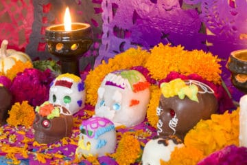 Marigolds and sugar skulls on a Dia de los Muertos altar