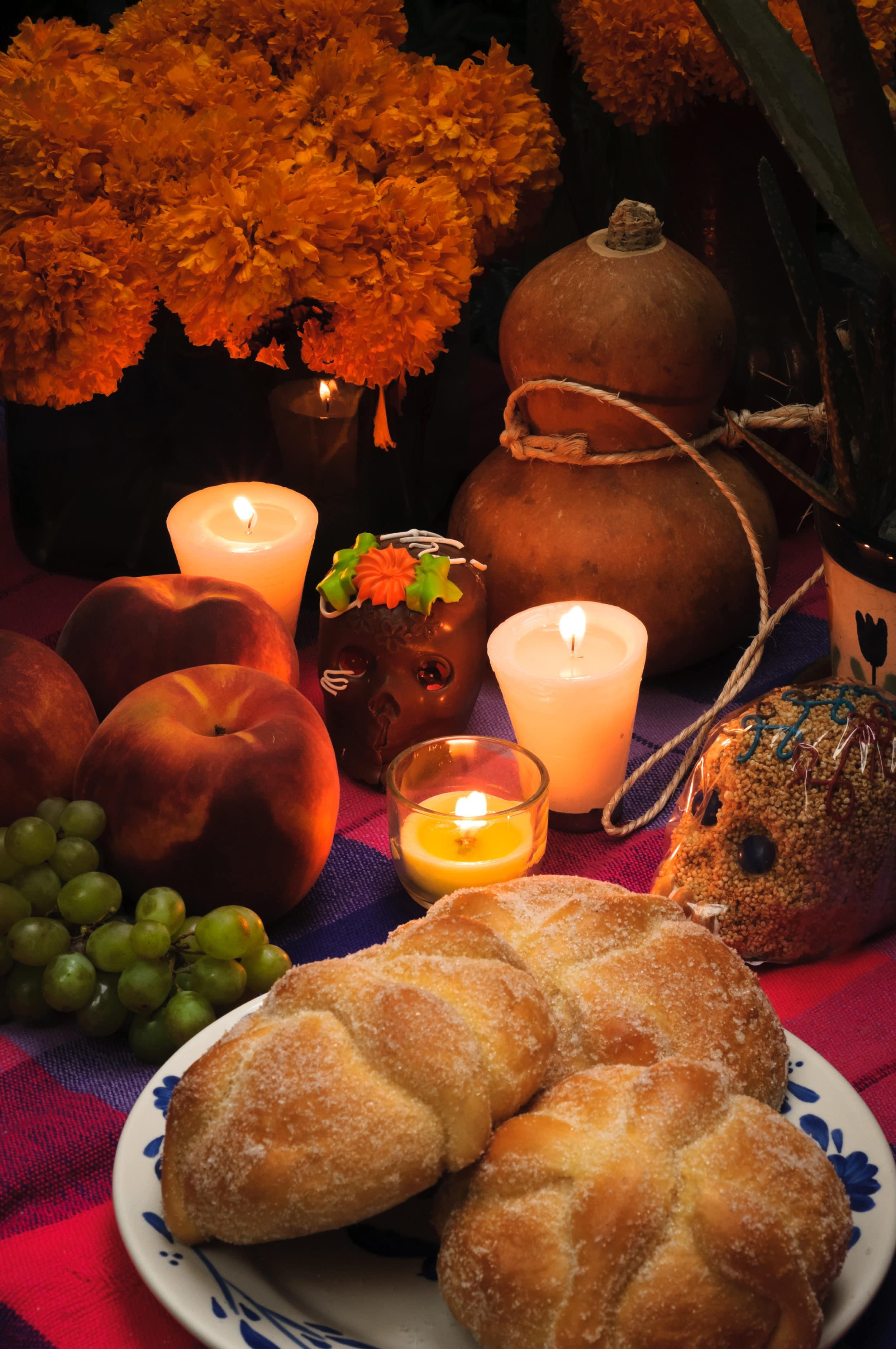 Pan de muerto on a Dia de los Muertos altar