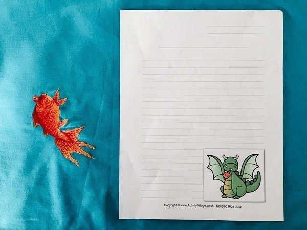 A free Chinese New Year printable that is a blank lined sheet with a zodiac animal.