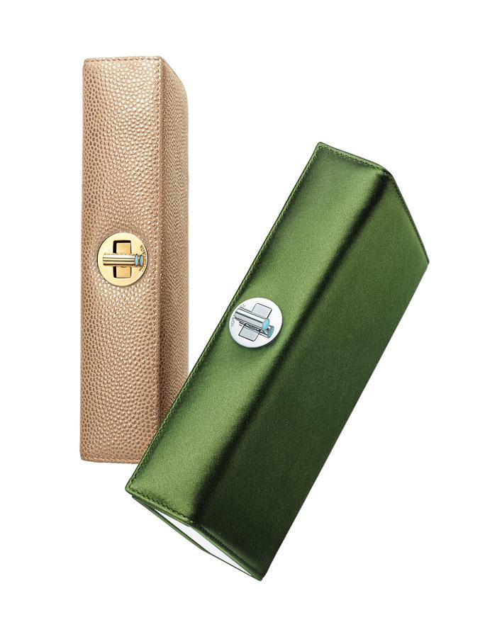 Tiffany Ava box clutches (from left): light camel metallic textured leather, bright moss satin. $1,195, $895