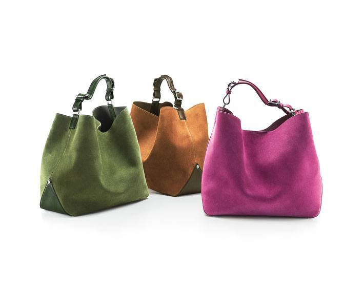 Tiffany Chelsea bucket hobos in suede with leather (from left): bright moss/bright moss, cognac/espresso, orchid/orchid. $1,150, $1,150, $1,150