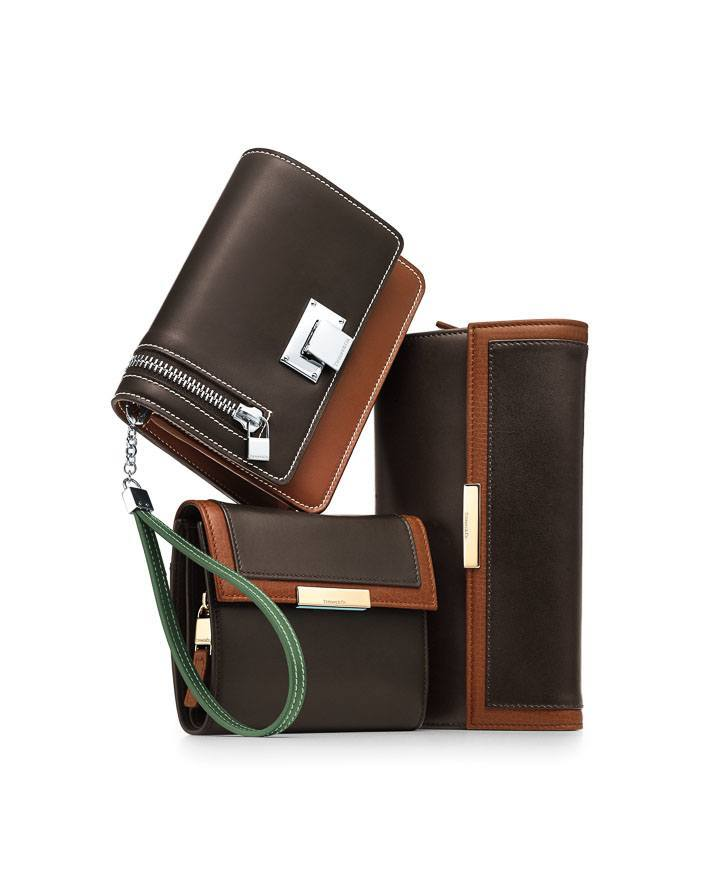 Tiffany accessories in smooth and grain leather (clockwise from top): wrist pouchette in espresso/cognac/moss, continental and french wallets in espresso/cognac.