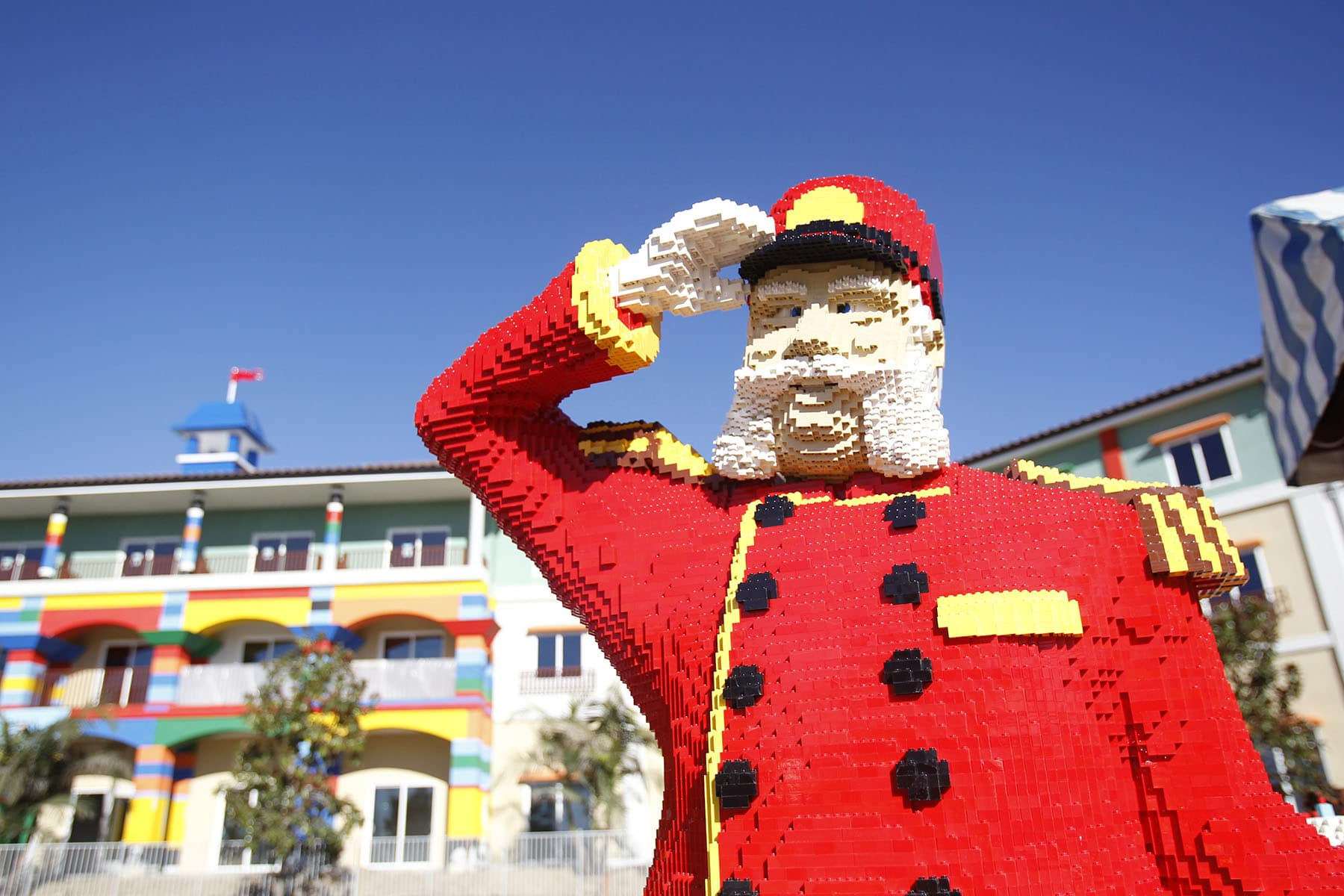 A LEGO bellman stands in front of the LEGOLAND Hotel in California