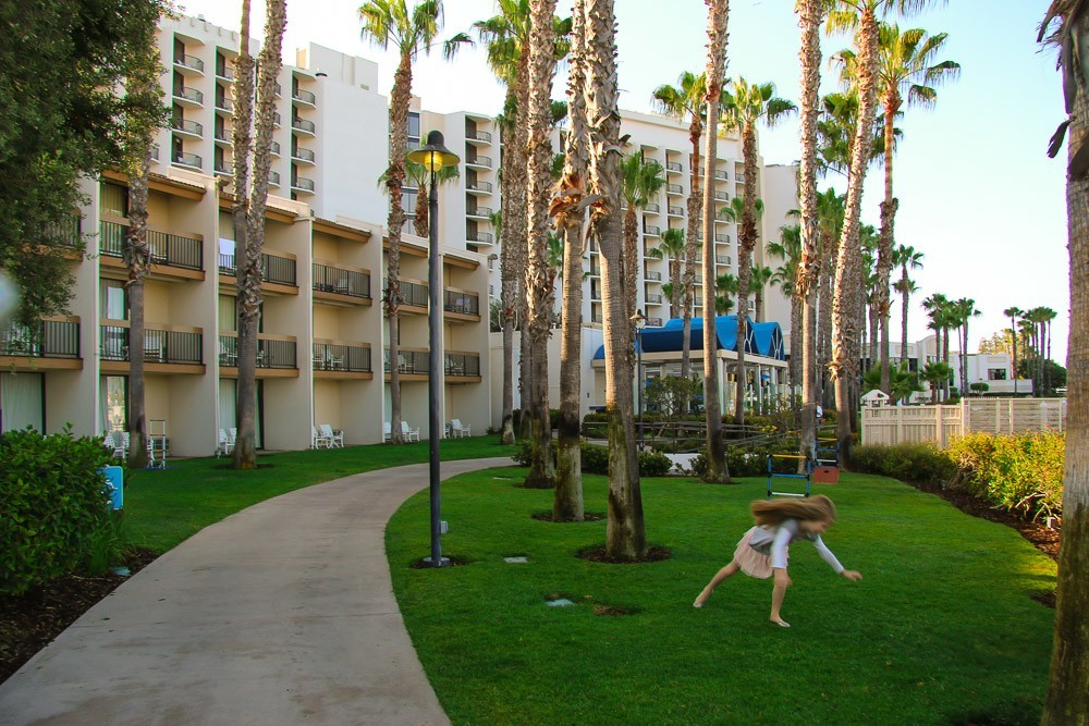 My daughter doing a cartwheel on the hotel lawn