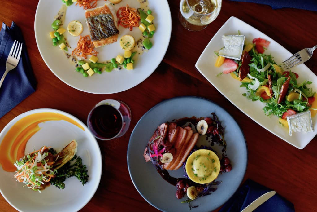 A flat lay of several of Executive Chef Ingrid Funes' spring and summer menu