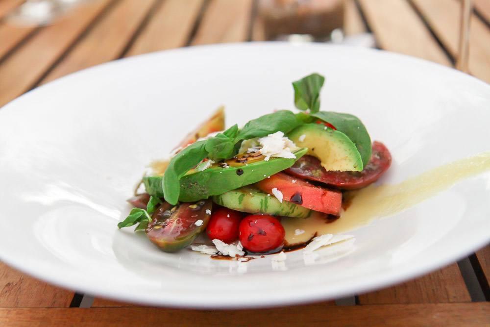 Kitchen 1540 Tomato +Tomahto Salad with Heirlooms, Avocado, Ricotta Salada, and More