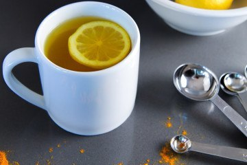 Learn the benefits of drinking warm lemon water with turmeric.
