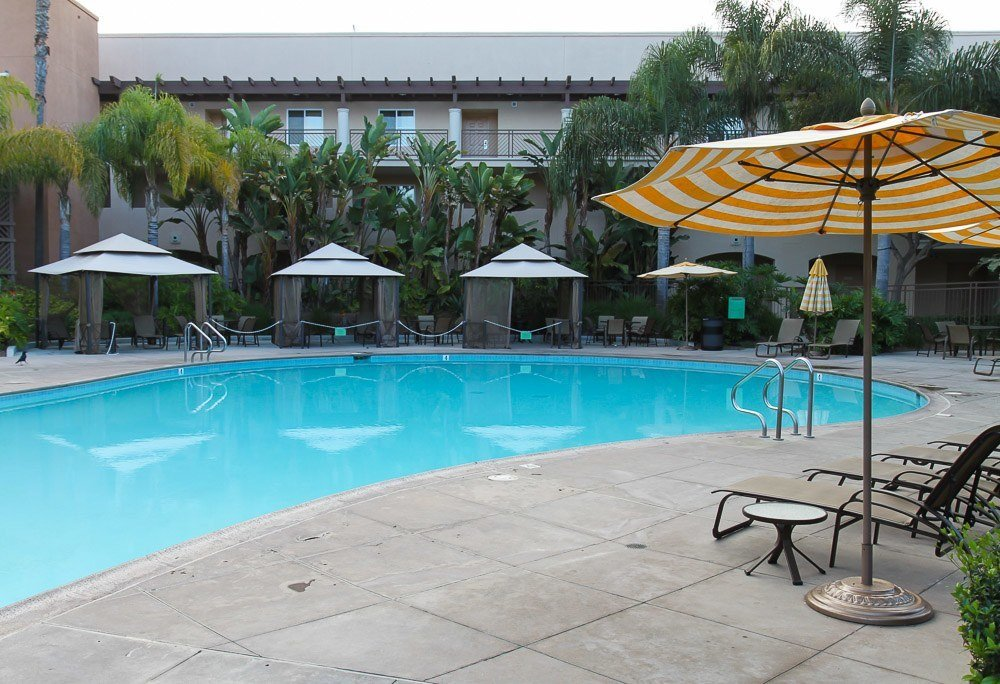 Family pool with cabanas and water play area at Grand Pacific Palisades in Carlsbad