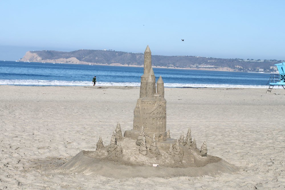 A sand castle by the Sandcastle Man in front of the Hotel Del Coronado