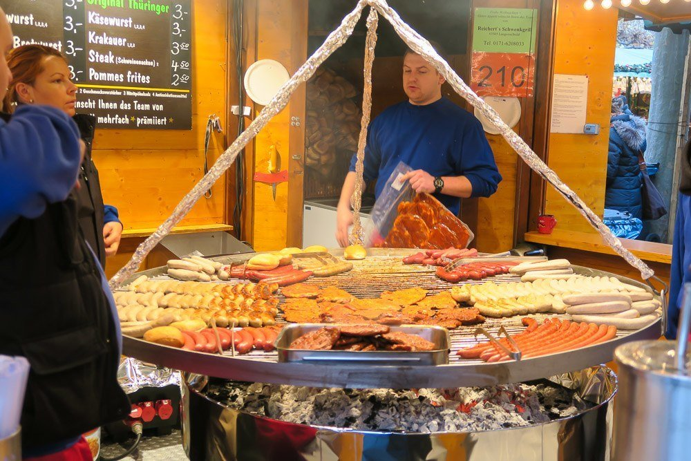 Bratwurst and other meats on the grill at the Frankfurt Christmas Market