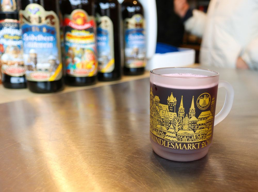 Drink gluhwein at the Nuremberg Christmas Market to warm up! Take the glass home as a souvenir.