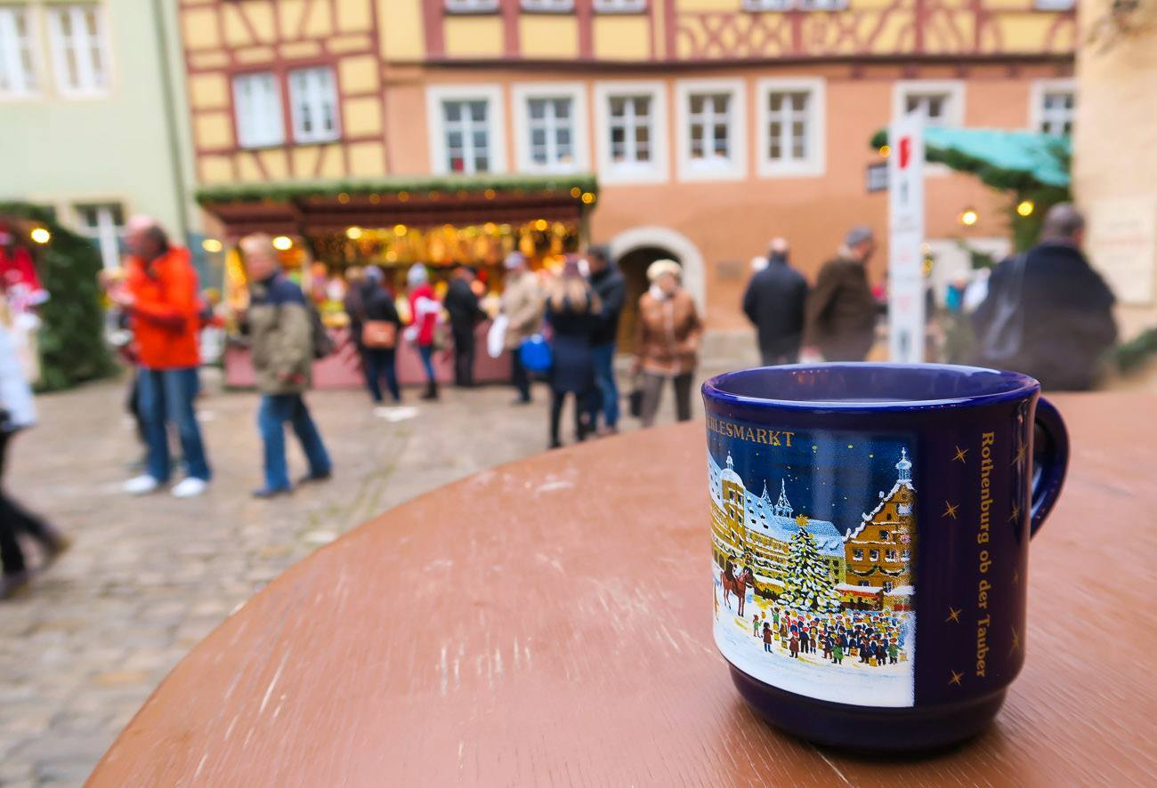 Warm up at the Rothenburg Christmas Market by drinking gluhwein