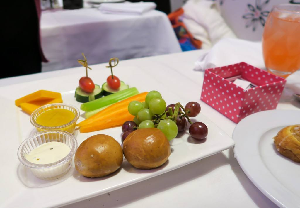 The second course of cheese, fruit, veggies and pretzel rolls.