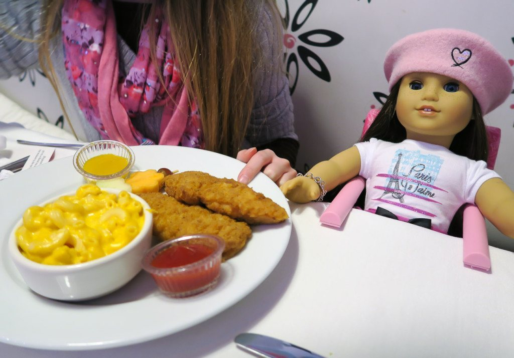 A kids meal of chicken tenders and mac and cheese.