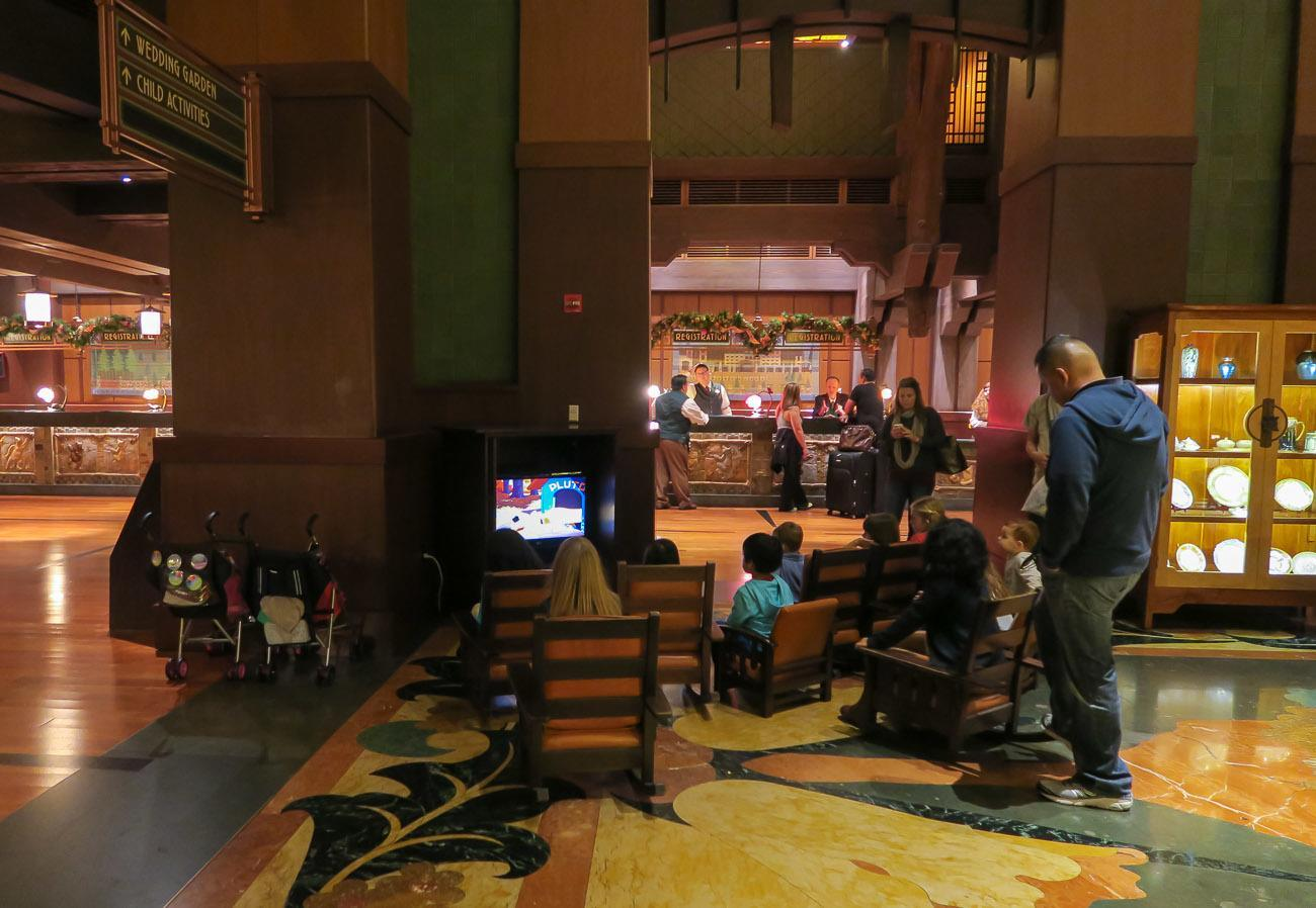 A TV plays Disney cartoons in the lobby of Disney's Grand Californian Hotel and Spa