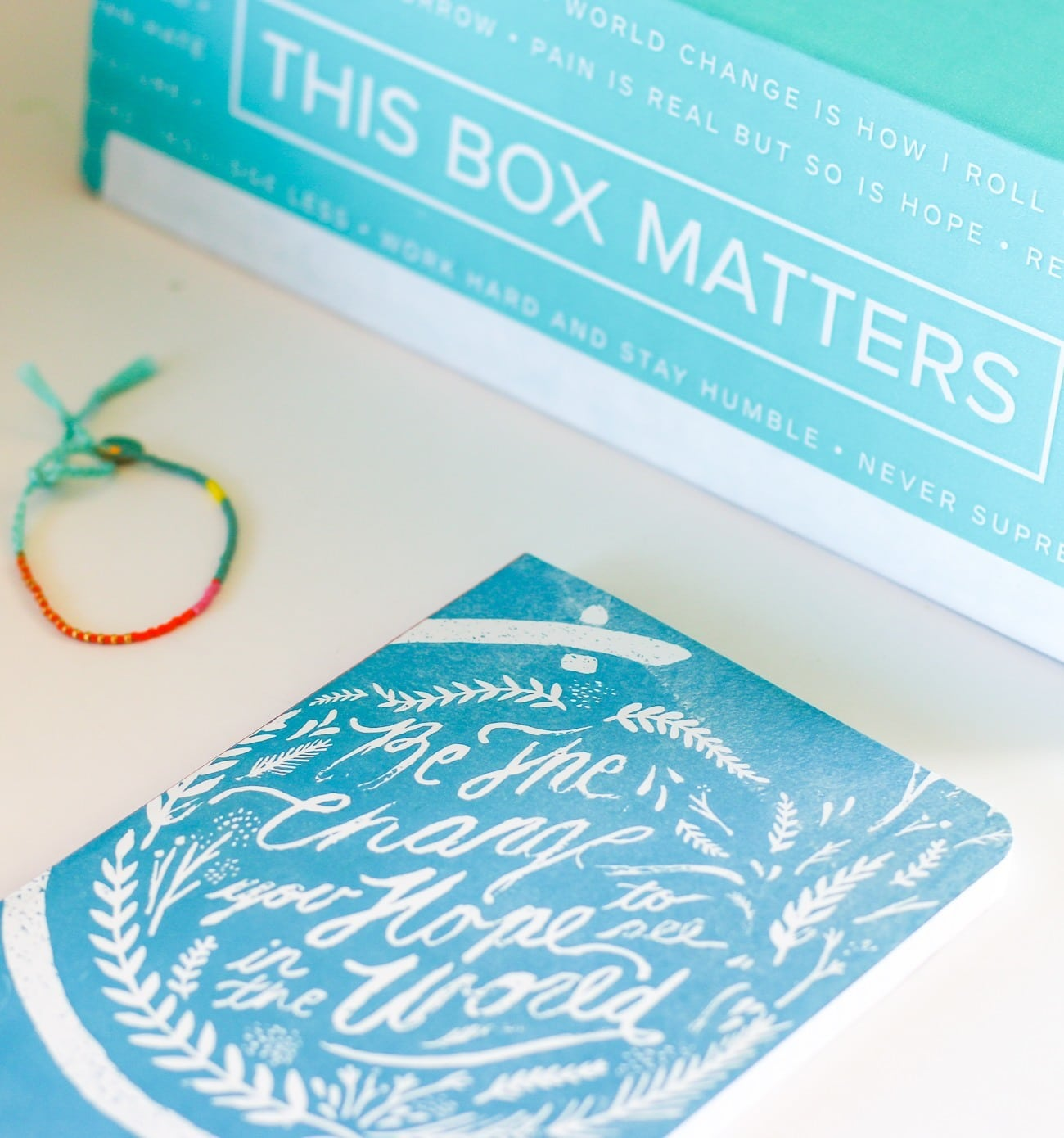 The Denik notebook and Tribe-Alive bracelet items in Sevenly's spring CAUSEBOX