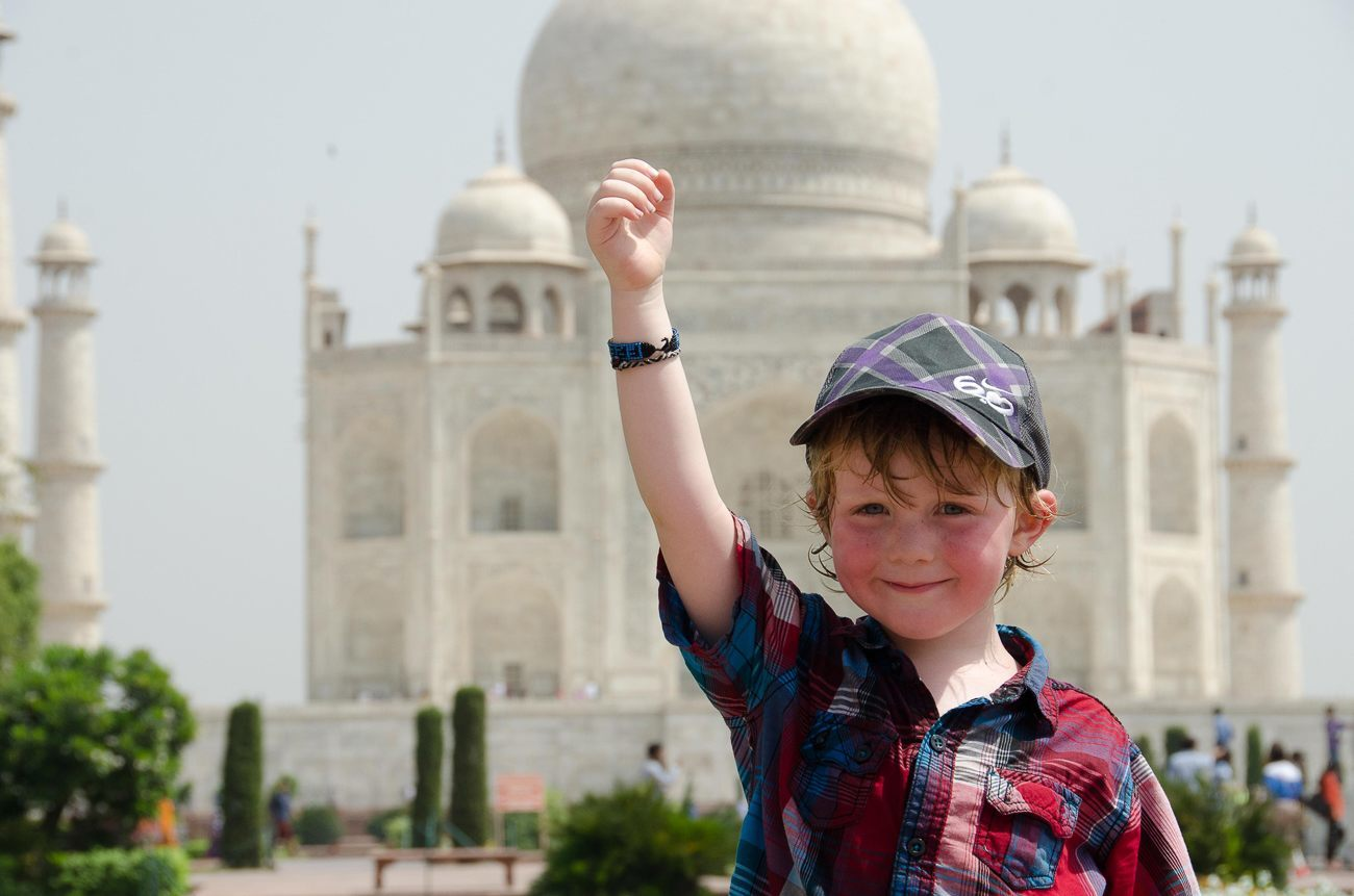 One of the kids on Big Crazy Family Adventure in front of the Taj Mahal.