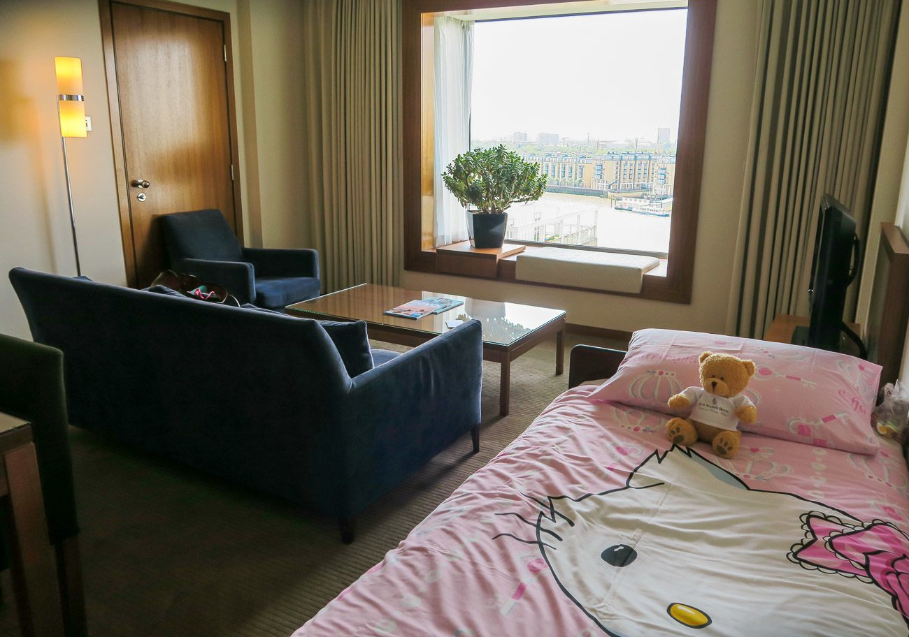 A rollaway bed with cute bedding for kids in a suite at Four Seasons Hotel London at Canary Wharf.
