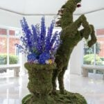An equestrian topiary with purple flowers at Four Seasons Hotel Hampshire, England