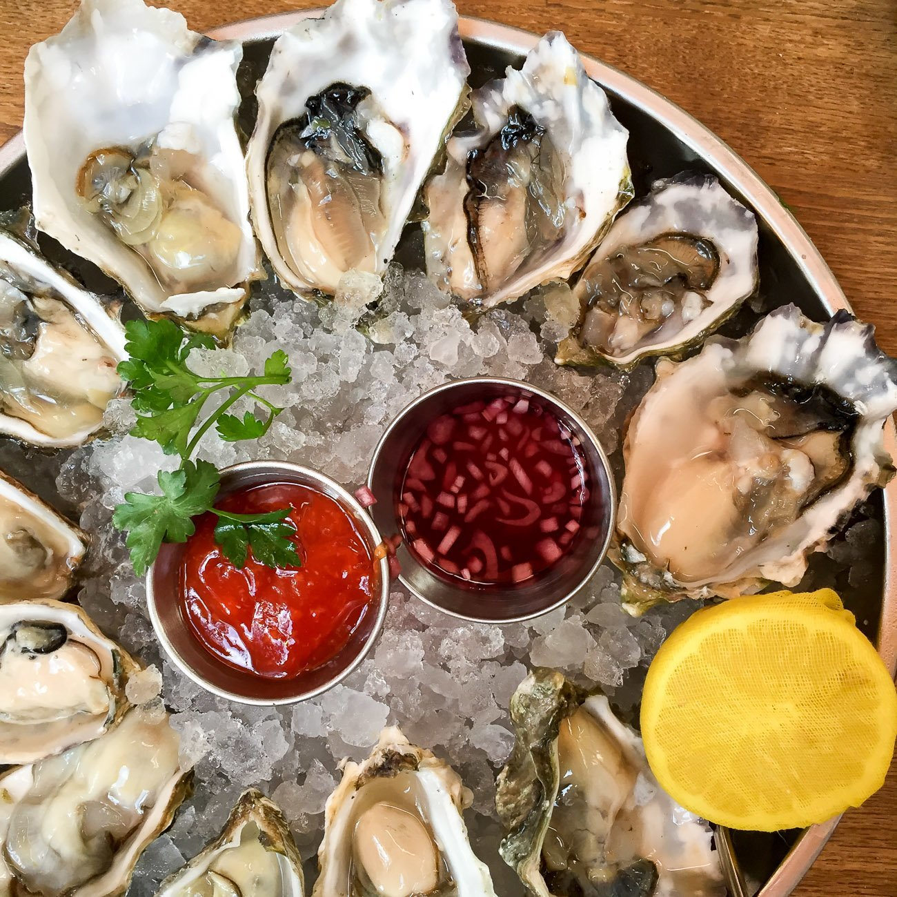 Oyster hour at Herringbone is on weekdays between 4:00 - 6:00 p.m. where oysters are $1 and other bites and some drinks are discounted.