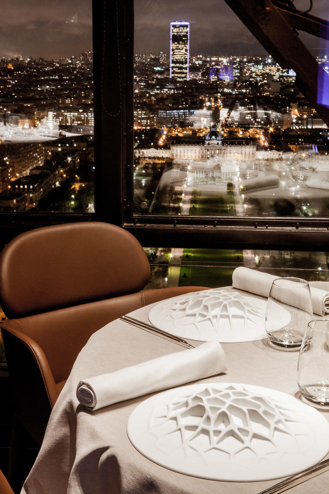 dining at the eiffel tower in paris france. the view from le jules verne restaurant on second floor of eiffel tower in dining at paris france e