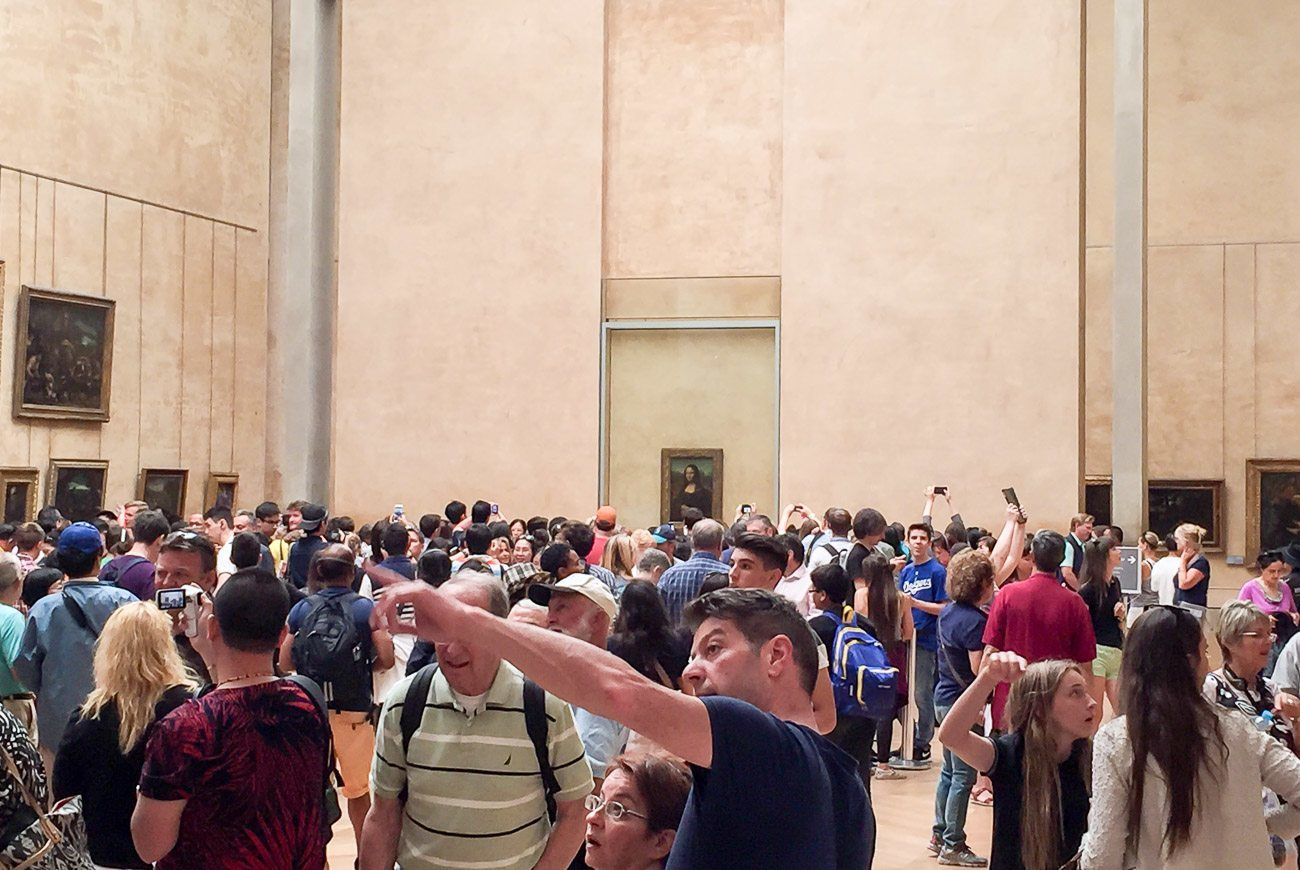 Crowds in front of the Mona Lisa  at the Louvre Museum in Paris