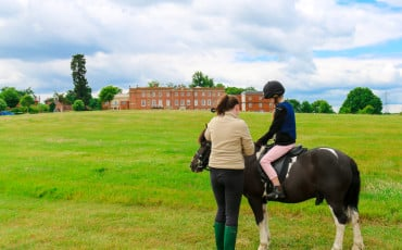 "Kids can ""own a pony"" at Four Seasons Hotel Hampshire, England. The luxury hotel has an onsite equestrian centre with 14 horses."
