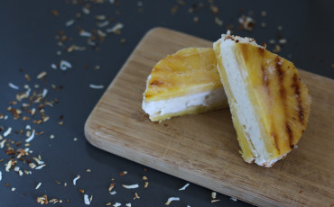 A recipe for a tropical ice cream sandwich using toasted coconut, Breyers ice cream and pineapple