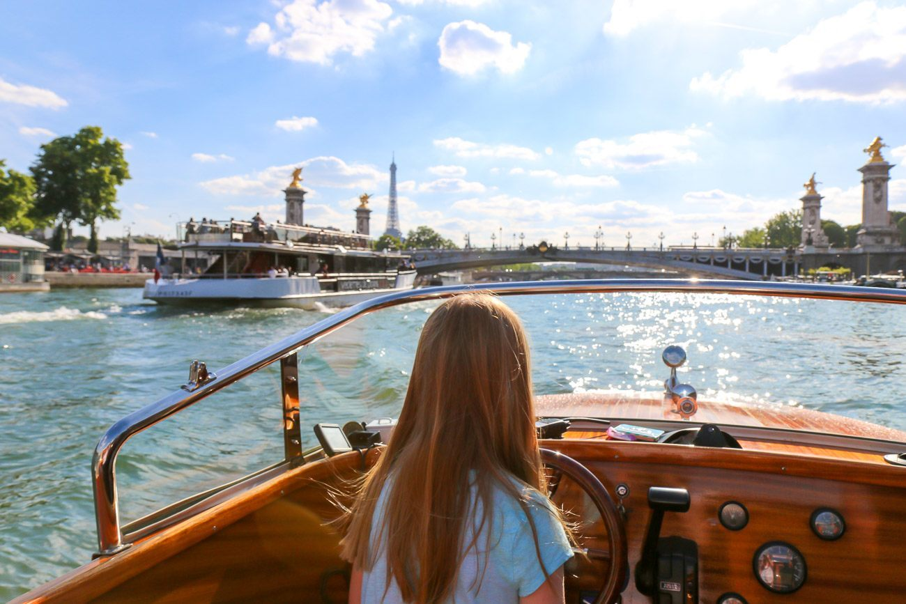 My daughter briefly drove the River Limousine boat down the Seine in Paris