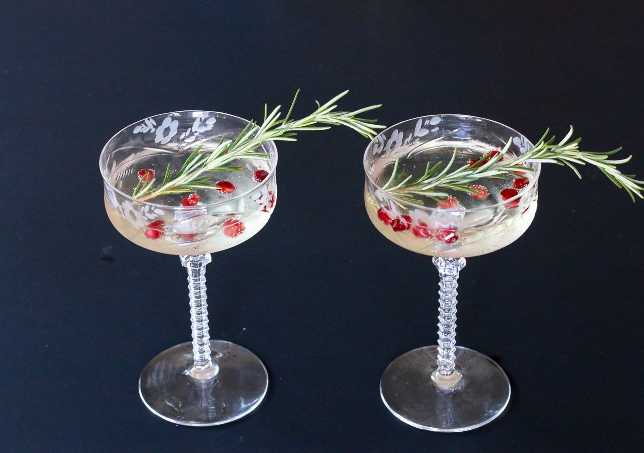 It's easy to garnish a champagne glass with herbs like rosemary and pomegranate seeds (perfect for the holidays) or even just a sprig of lavender.