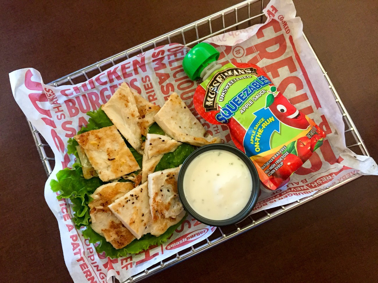 Smashburger kids' meal with grilled chicken strips and applesauce