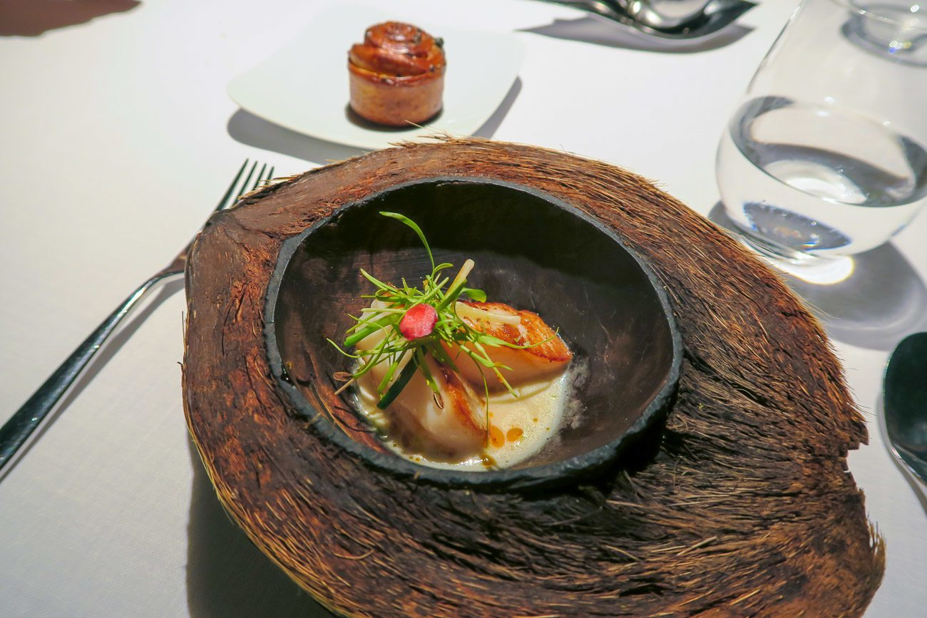 Roasted scallops in a coconut bowl at ABaC Restaurant in Barcelona
