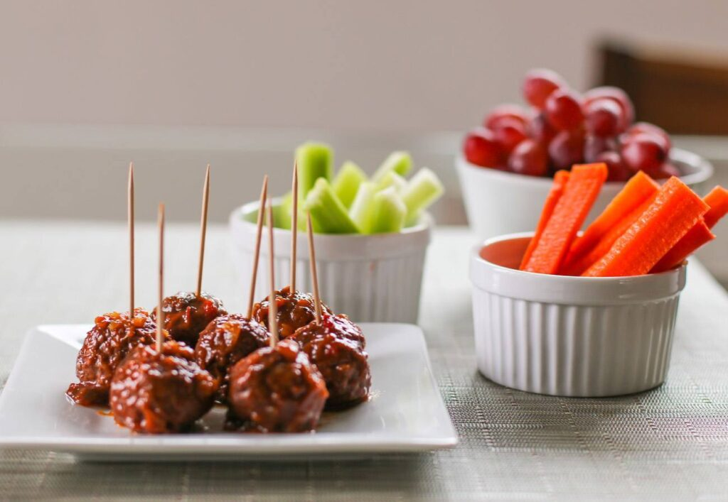 A three-ingredient slow cooker recipe for Hawaiian meatballs that is perfect for game day.