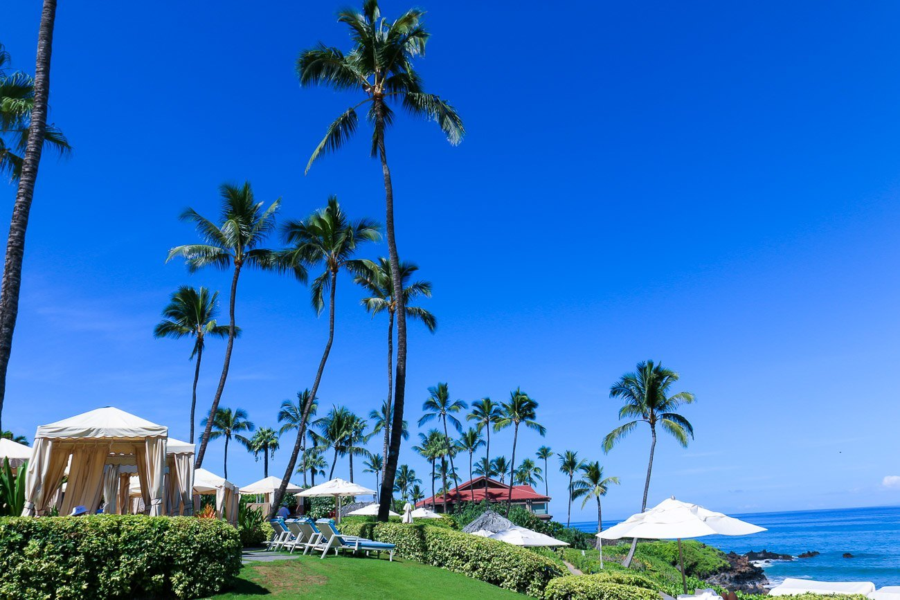 Cabanas near the beach at Four Seasons Resort Maui at Wailea, a family-friendly vacation option.