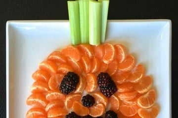 Your kids can make this easy and healthy Halloween snack in the shape of a jack-o-lantern.
