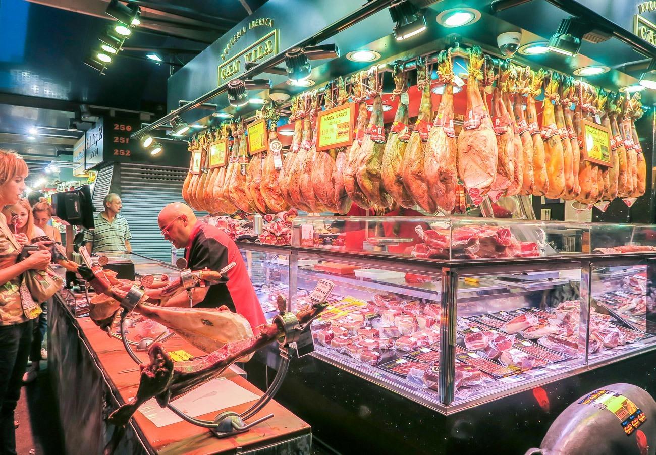 A meat vendor in La Boqueria Market in Barcelona.