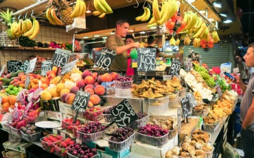 A fruit and vegetable stand at La Boqueria Market in Barcelona