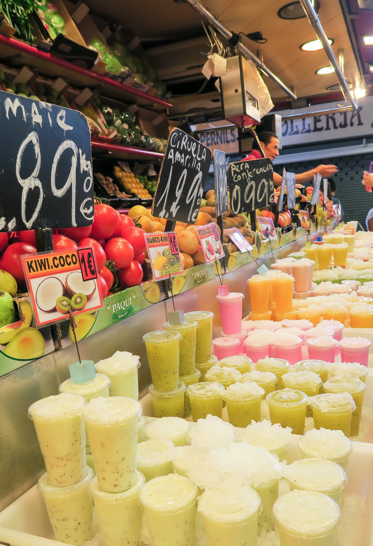Fresh juice in a variety of flavors is sold all over La Boqueria Market in Barcelona.