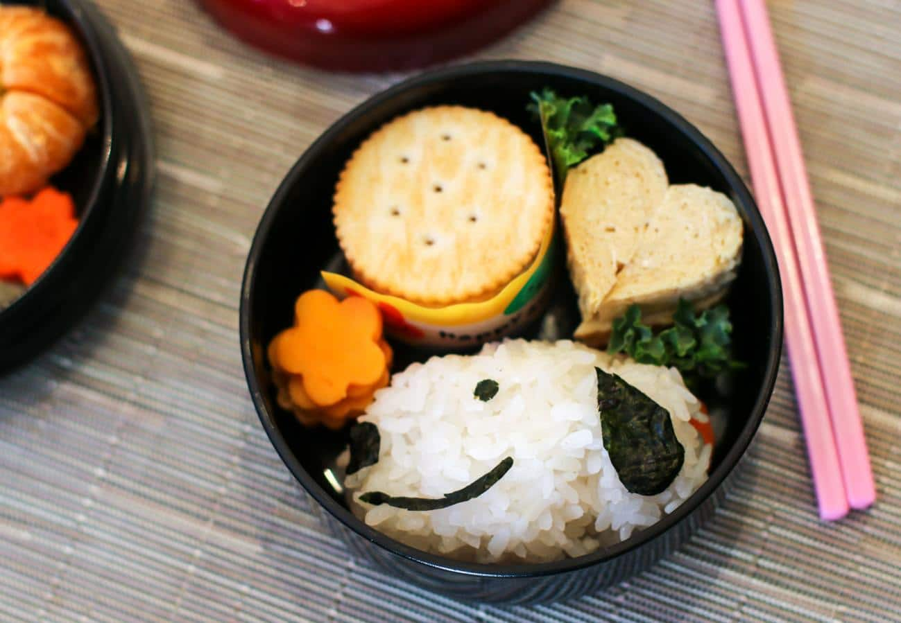 Snoopy bento box for kids with tamago, crackers and cheese (fruit and veg are in the unpictured layer)