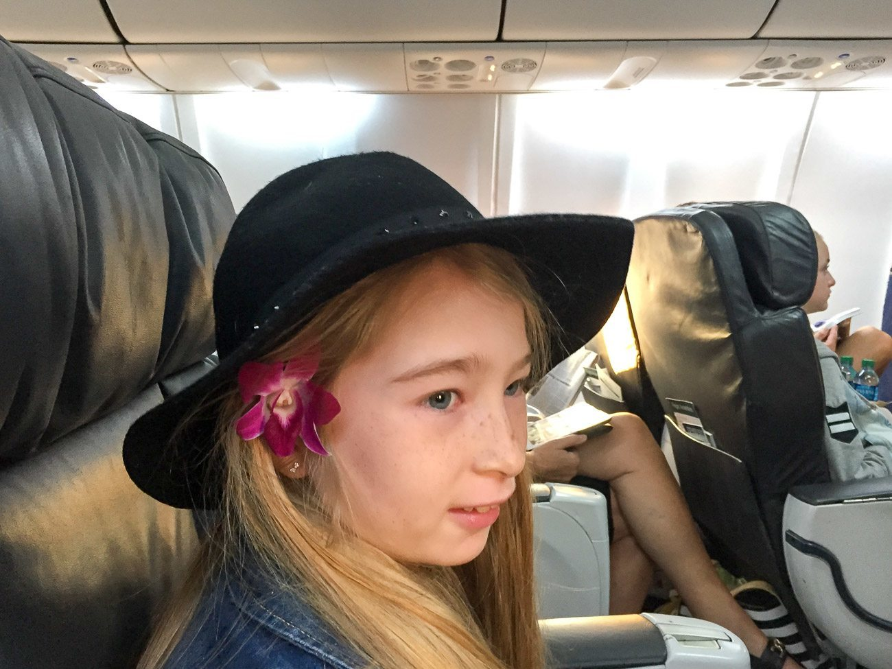 The Alaska Airlines flight attendants placed flowers in the ears of children on board before take-off.