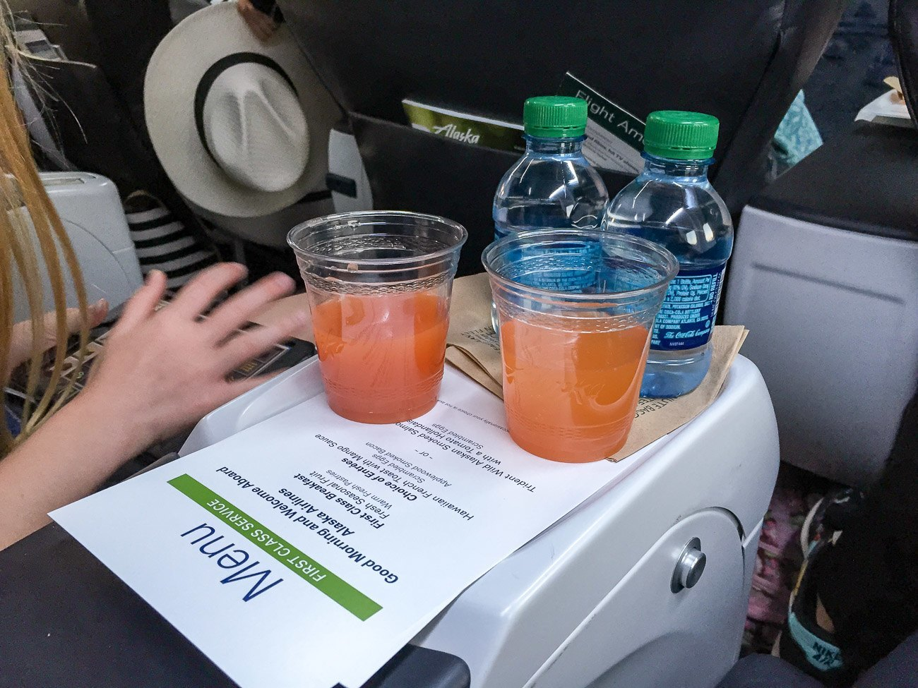 Alaska Airlines first class passionfruit mimosa served at San Diego International Airport before departure to Maui.