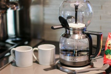 The KitchenAid Siphon Coffee Brewer modifies this centuries-old craft for home use.