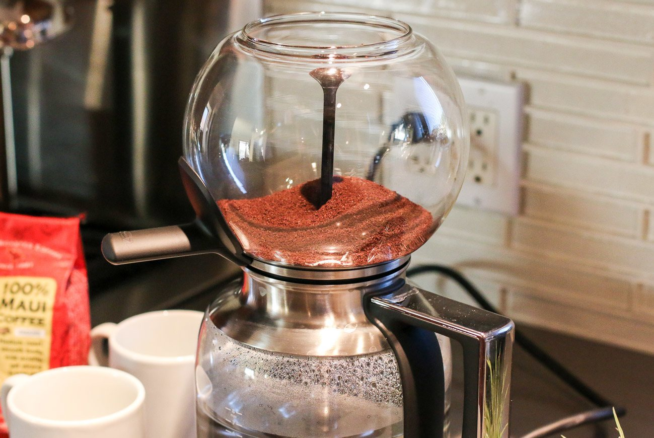 ground coffee inside the brew unit of a kitchenaid siphon coffee brewer